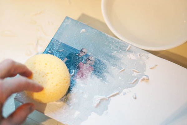 Use a sponge and water to remove paper back.